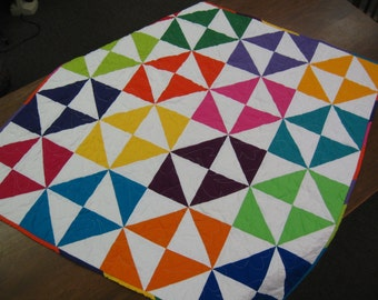 Free shipping in the U.S. for this bright and fun Broken Dishes pattern Baby Quilt
