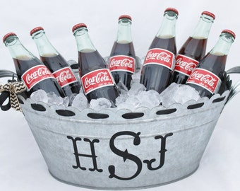 Beverage tub with monogram or name. Scalloped edge with ribbon.