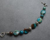 One of a kind, hand-made,  Aqua Terra Jasper and Sterling Silver large size bracelet with a Sterling Silver toggle clasp.