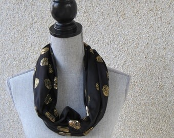Fabric scarf, Infinity scarf, tube scarf, eternity scarf, loop scarf, long scarf in a black jersey knit with gold metallic motif