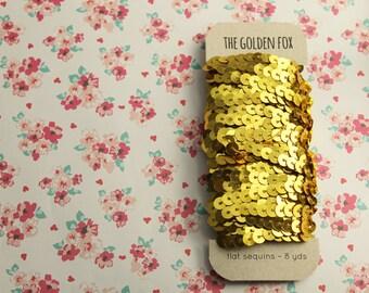 threaded gold flat sequins [8 yds]