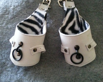 White suspension cuffs with zebra print lining