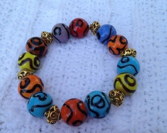 Ceramic beads, metal spacers and elastic bracelet