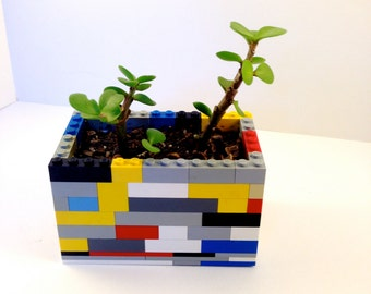 Planter made of legos.