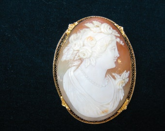 Hand carved authentic Cameo brooch set in 14k gold