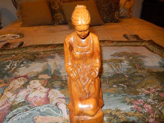 Israel omar bakri wood carving of woman
