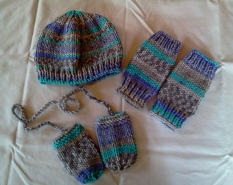 child's hat, leg warmers and thumbless mittens on a string.