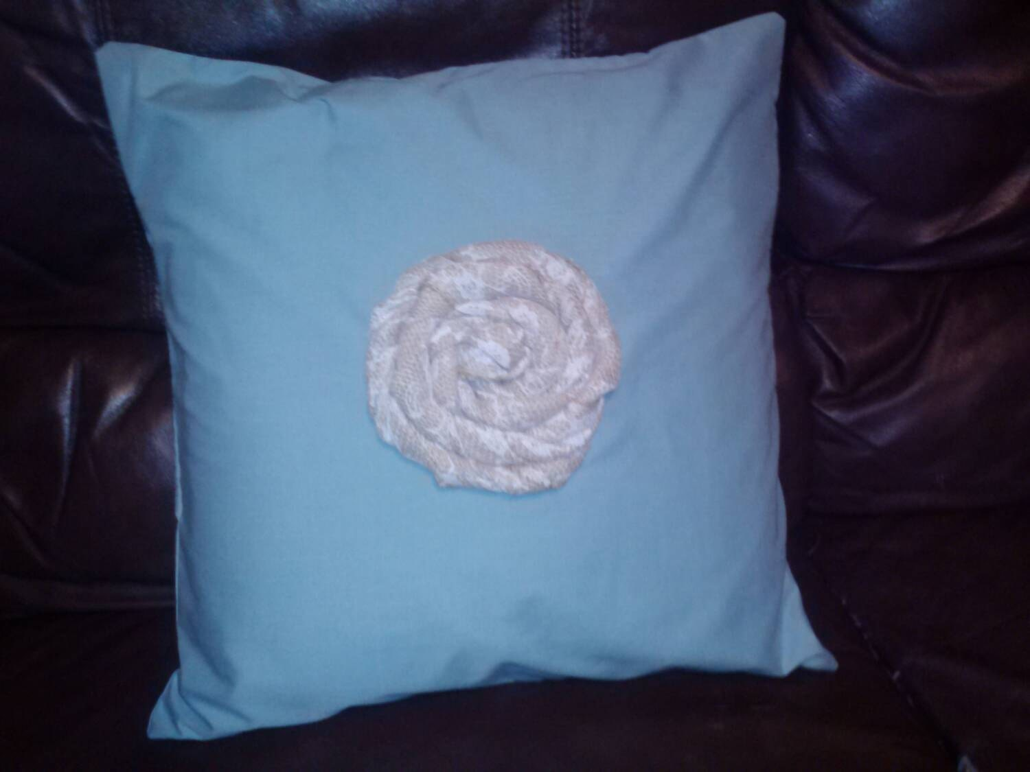 12 x 12 in blue pillow cover with lace covered burlap Rosette.