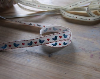 Bird and heart ribbon, blue birds with red hearts on a grosgrain ribbon.