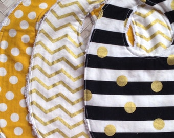 Set of three coordinating bibs