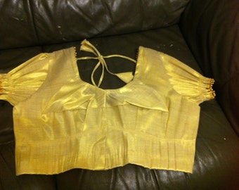 shiny gold blouses made of comfortable material.sleeves and back has gold beads.its a must have blouse for all ladies!