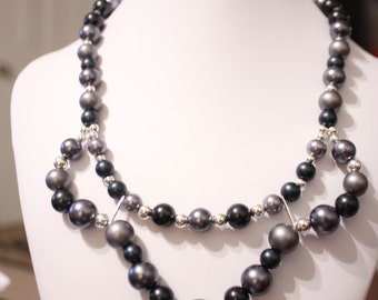 Radiant Silver And Pearl Necklace