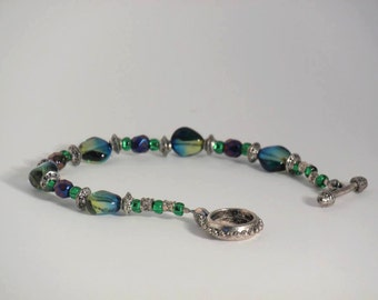 Blue and green glass beaded bracelet with silver accents.