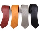 Repurposed automotive leather necktie. Perforated leather tie, cowhide. Choose black, burnt orange, oxblood or dove gray.