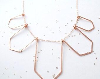 5 geometric silhouette necklace