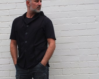 Men's Black Hoodie Waistcoat. Raw edges, exposed seams and hand made buttons. Minimalist mens fashion clothing for him.