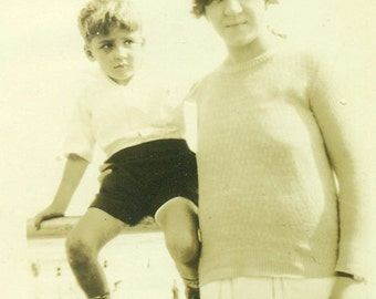 Unsure Little Boy Sitting on Fence Rail With Mother Beach Ocean Vacation Vintage  Black White Photo Photograph