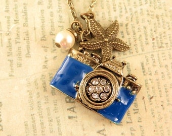 Love the Sea. a vintage camera necklace adorned with  pearl and starfish