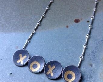 Gold On Black - XOXO necklace
