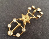 Antique golden Star precious jewelry buckle.