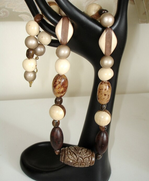 Ashira Lush Combination of Banana Bark, Wood Beads, Natural Amazon Pona Bombona Palm Seed Beads with Carved Jade Focal Pendant