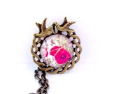 SALE. Spring flowers and poppy pendant. Antique brass. Swallow setting. Pretty and feminine glass cabochon