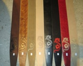 Leather guitar strap with dragon symbol embossed or embroidered