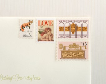 Send 8 two ounce cards - Love Cherub, Wildlife, and Metropolitan Opera - Unused vintage postage stamp set