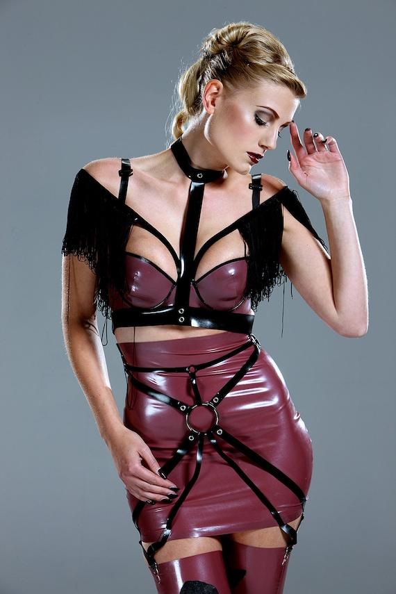 Redhead in latex harness