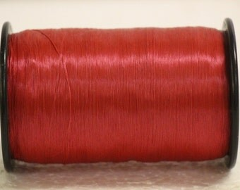 Large vintage spool bright red acetate fiber