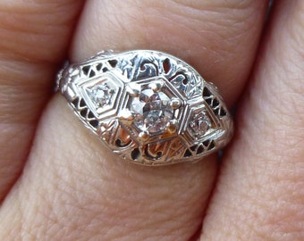 Beautiful 1920 Vintage Filligree in 18Kt white gold with a 25 point center diamond set diamond SI1 F color diamond