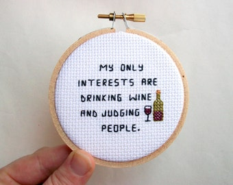 Wine and Judgment cross stitch -- tiny wine glass and bottle completed mini cross stitch
