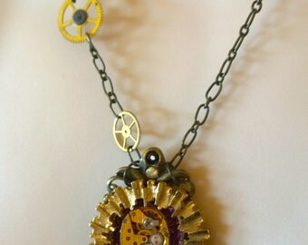 Steampunk Necklace with Gold Clock Parts and Pearls and Purple Accent