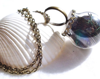 Peacock feather glass orb ring on antique bronze chain