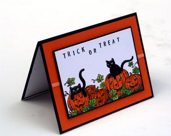Halloween card, trick or treat, black cats, pumpkins, Jack-o-lantern, orange and black blank card, happy halloween