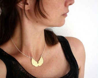 Winging, brass and sterling silver wings necklace
