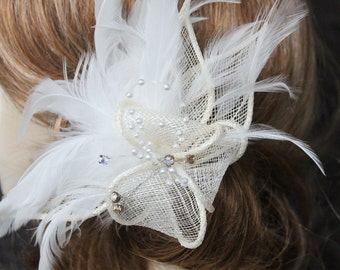 Cream    color    flower  clip  with white feather
