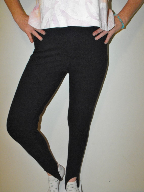 Nice navy blue stirrup pants with a waist band thathas elastic in the back. There is a sewn crease down the front ofeach leg. Pants close with a hidden zipper and onebutton.