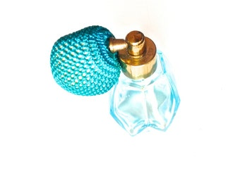 Vintage blue coloured perfume atomiser spray bottle glass dressing table cosmetics ladies star decoration antique
