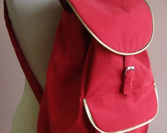 Red backpack with gold decoration