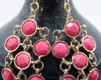 Pink dangle earrings.