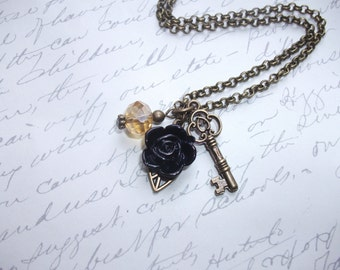 Vintage antique brass necklace with key and flower charms