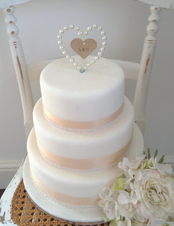 pearl heart wedding cake topper items similar to personalised pearl wedding cake 18164