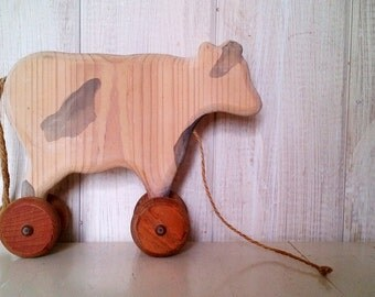 Primitive Black & White Wood Cow Pull Toy on Wheels Decoration