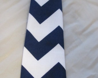 Baby Boy/ Toddler Navy Blue Chevron Tie.  It will fit a baby to a 2 year old.