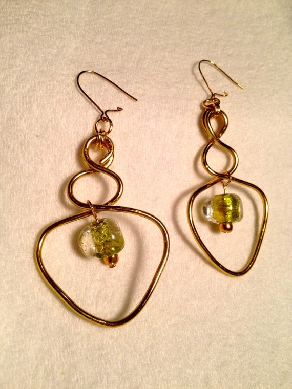 Brass earrings with flattened wire work and clear light green glass beads