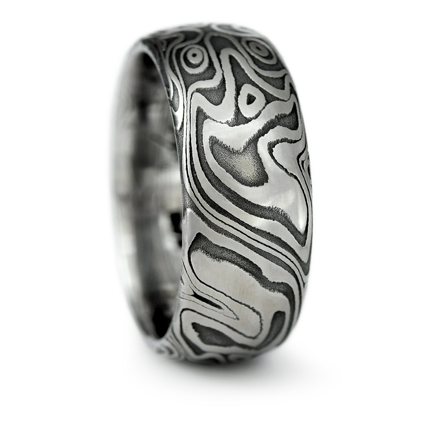damascus steel ring with white gold damascus steel wedding bands Damascus Steel Domed Wedding Band with Four Pointed Swirling Star Pattern with Dark Fire Patina Bold Masculine Handmade Wedding Ring