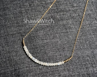 Gold Filled Necklace - Row of faceted crystal beads and tiny gold filled beads.