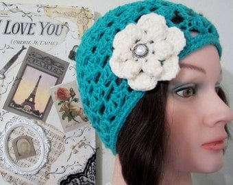 Cloche - Woman's stylish aqua blue hat embellished with contrasting flower motif. Imitation pearl button.  Trendy style for any occasion!