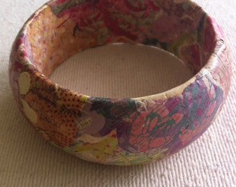 """Wood bangle with springy floral paper mache design, 2.75"""" wrist, 3.25"""" outer diameter."""